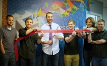 Alex and team cut the ribbon at our grand opening